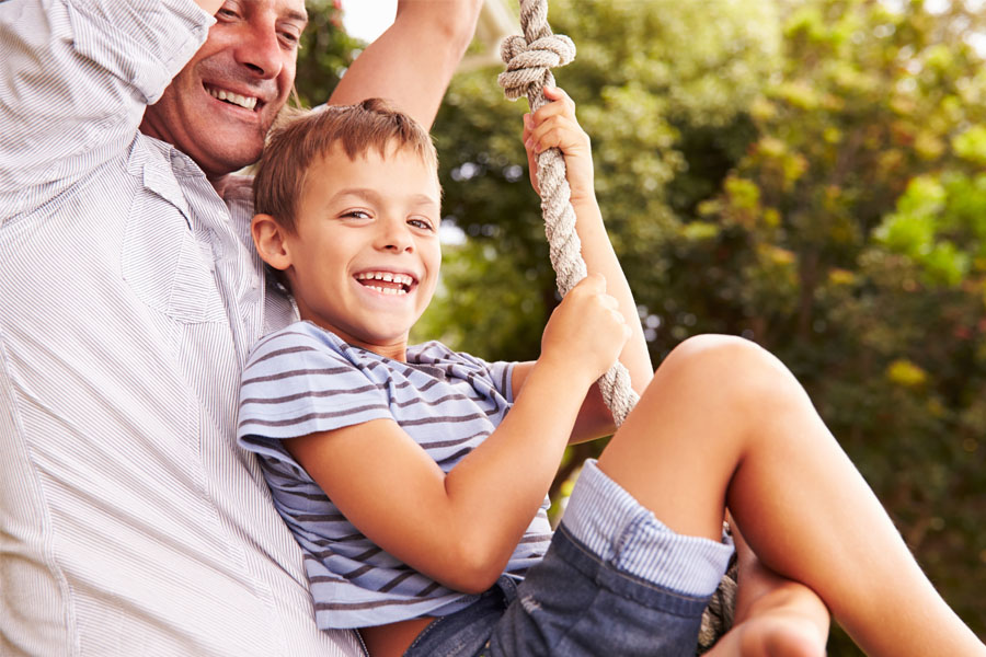 Header - Personal Insurance Father and Son on Swing